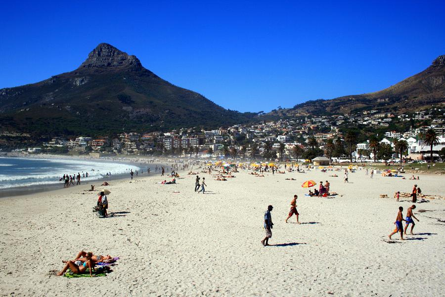 Camps Bay beach is backed by a palmtree-lined street filled with upmarket