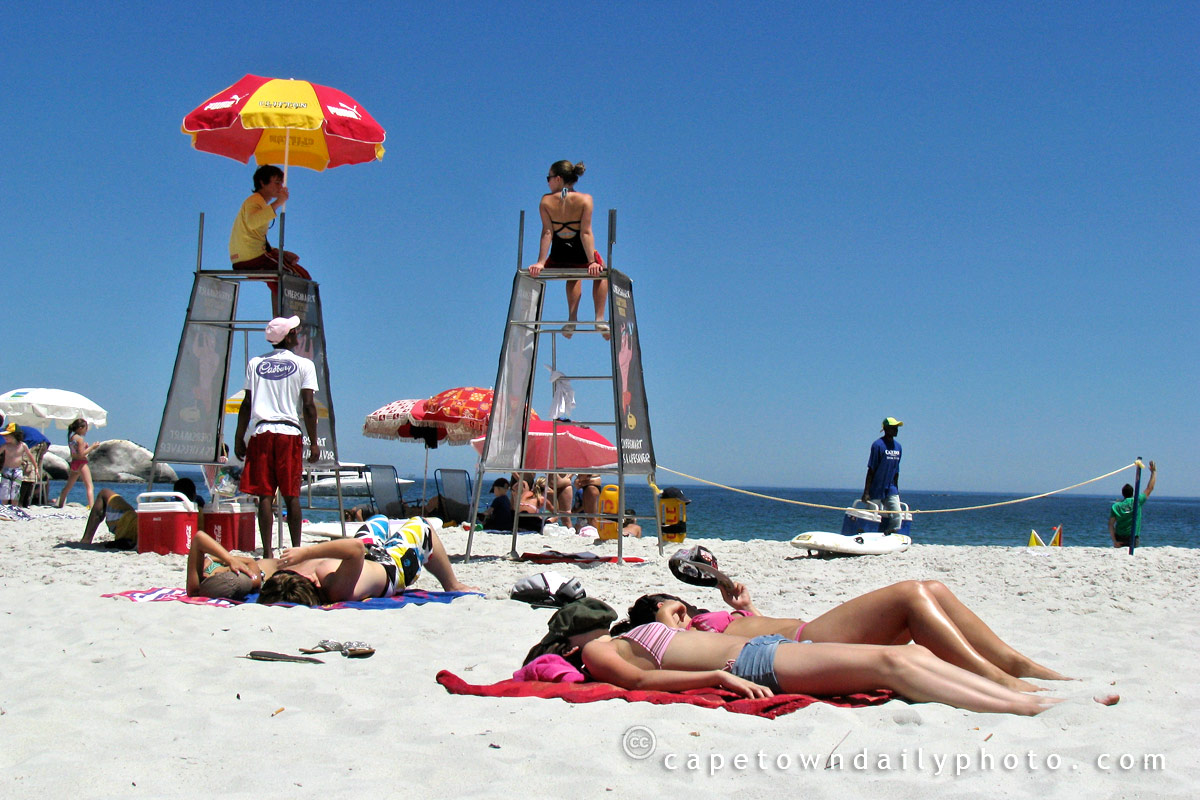 Girls and lifeguards on Clifton beach