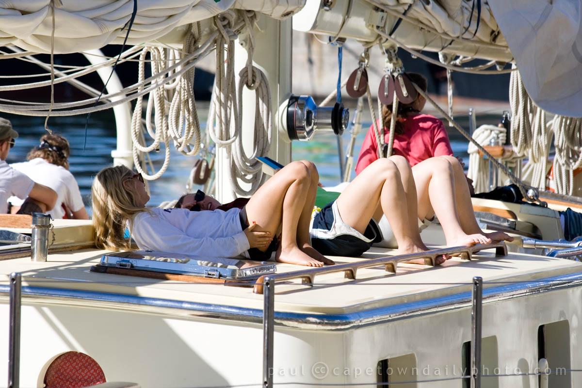 Girls tanning on the Argo yacht