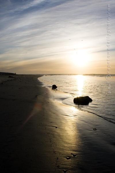 Sea, sand, and a setting sun