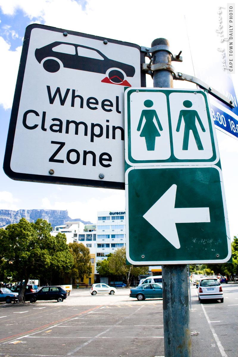 Wheel clamping toilet sign