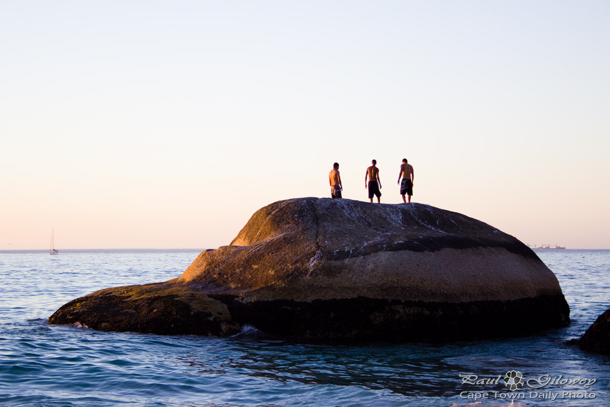 Three guys on a rock