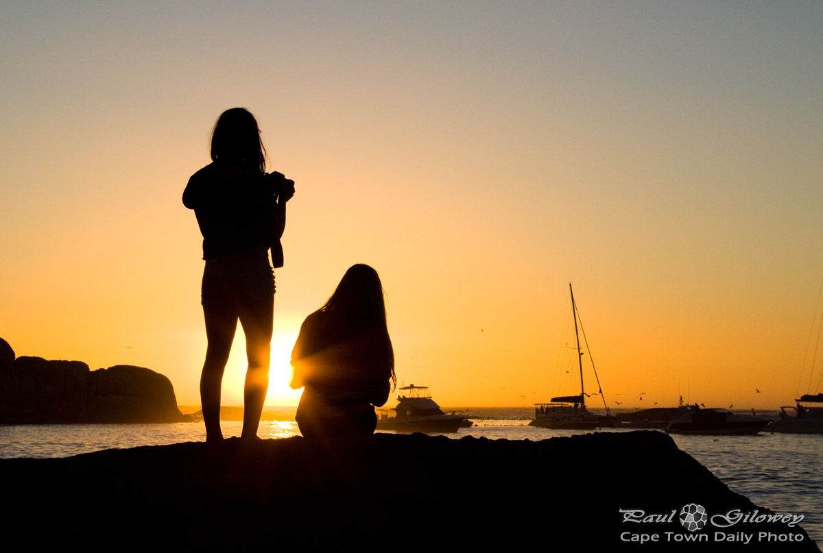 Two girls playing near the seaby angelo luna - 1 5