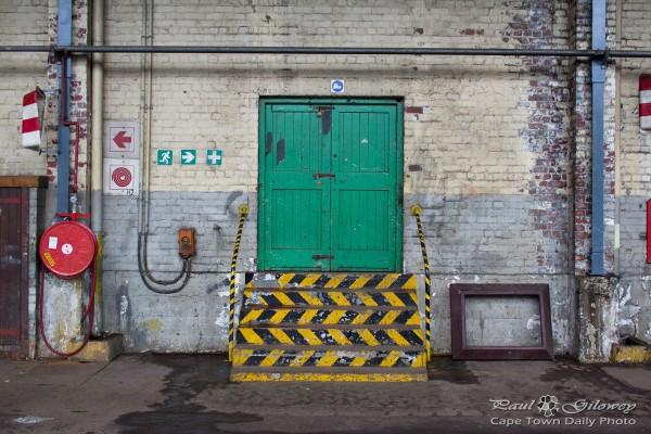 Green doors and chevron stairs