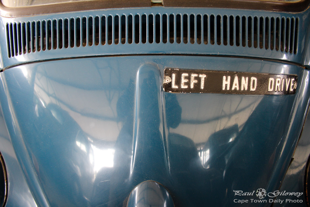Car with a left hand drive sign