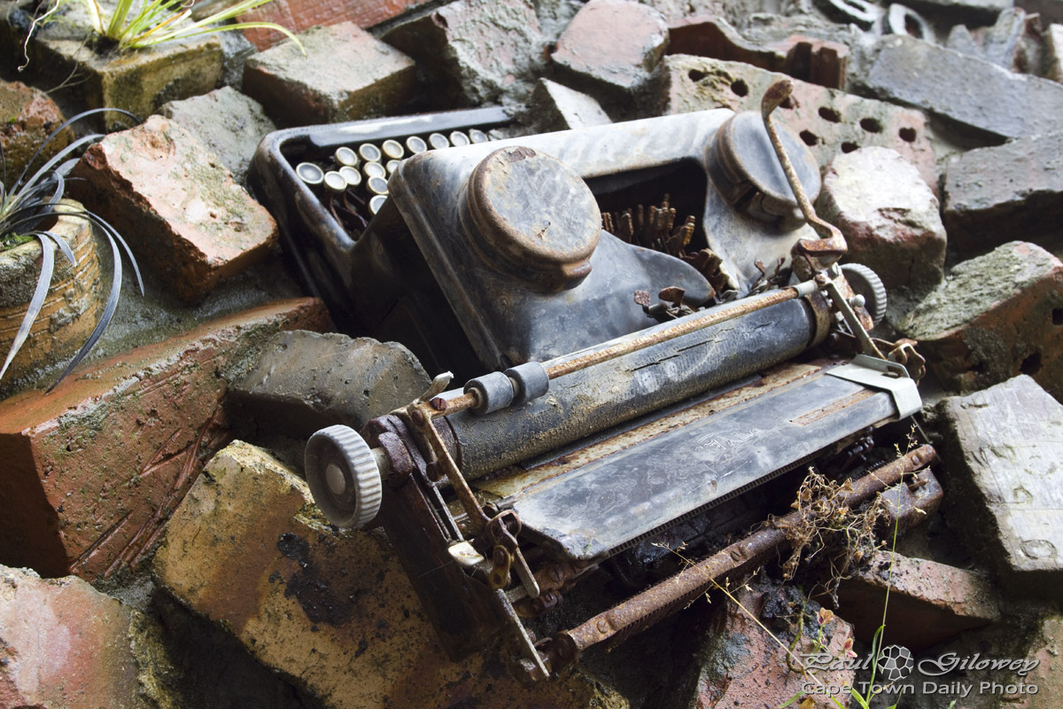 The Wall: Rusted old typewriter