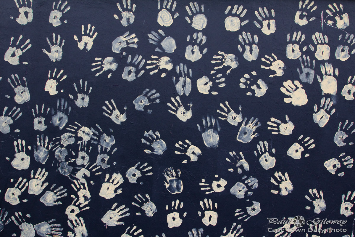 Handprints on a black wall