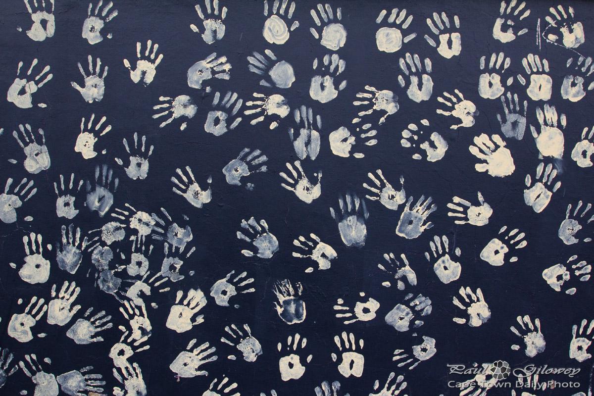 Handprints on a black wall