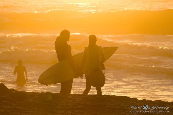 Golden surfer silhouette