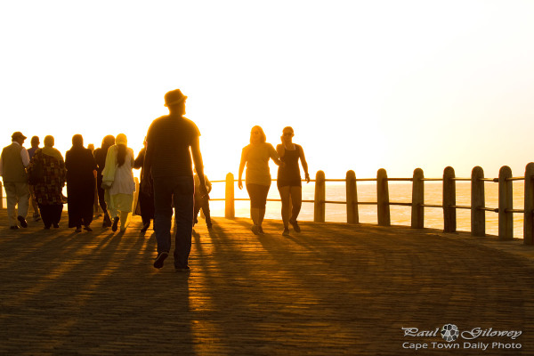 A busy promenade sunset