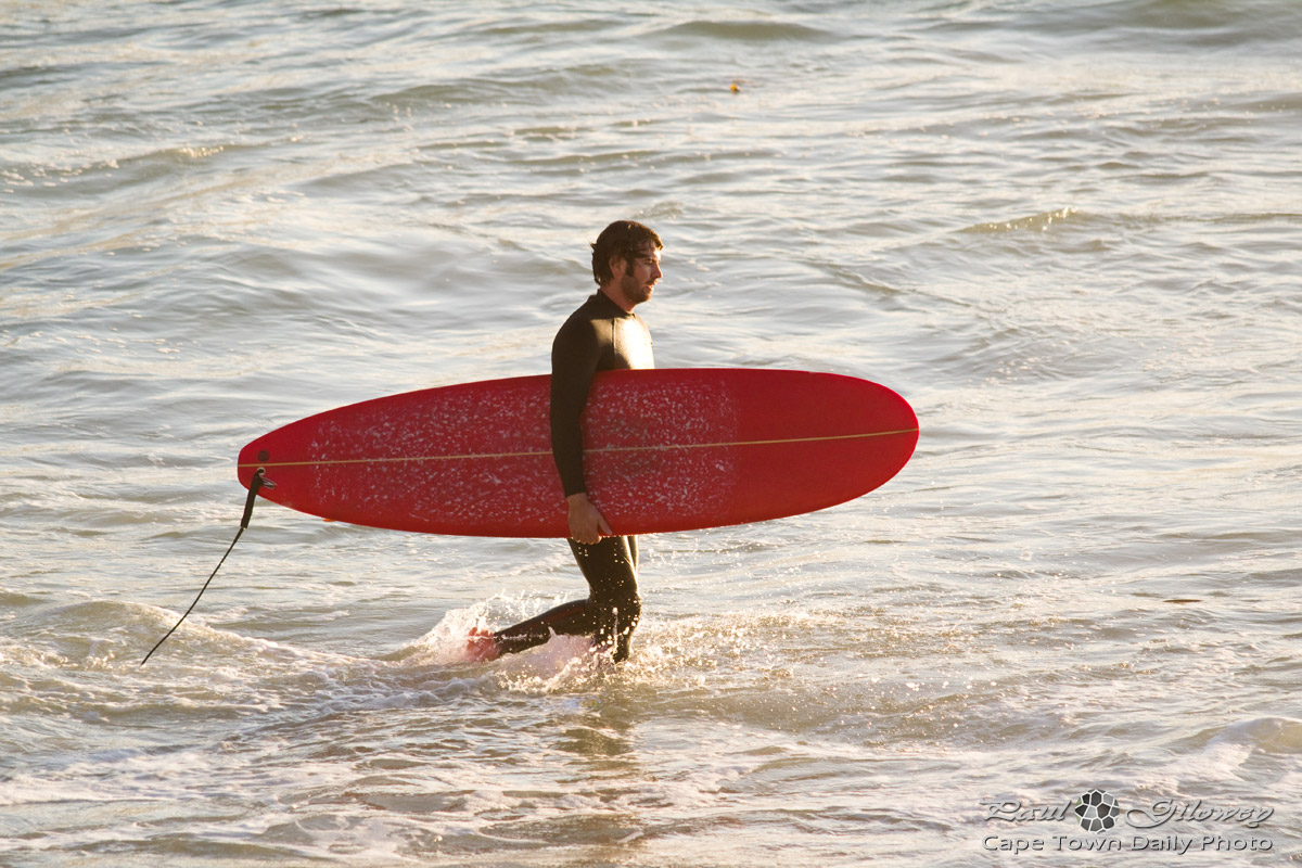 Red board surfer