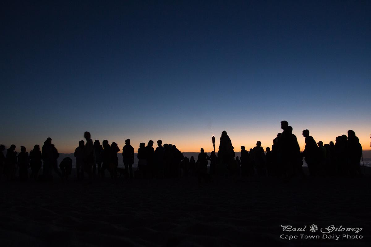 Silhouette of a crowded beach